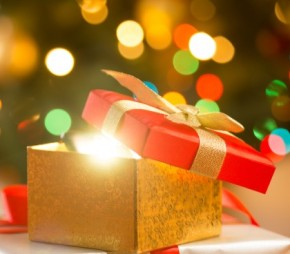 Closeup photo of glowing magic Christmas gift boxes